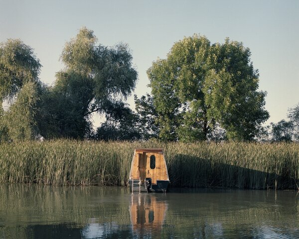 """""""As an architect, I found it highly interesting to conceptualize and design a living space that has no tangible groundwork or foundations,"""" Bene says. """"The boat gives us an opportunity to spend time, eat, drink, sleep, and awaken nearly anywhere, while blurring the boundaries between our personal selves and nature."""""""
