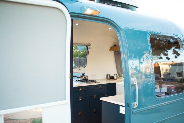 The exterior of the chassis was brought back to life with a fresh coat of paint in a blue-gray hue inspired by Mercedes-Benz Sprinter vans.
