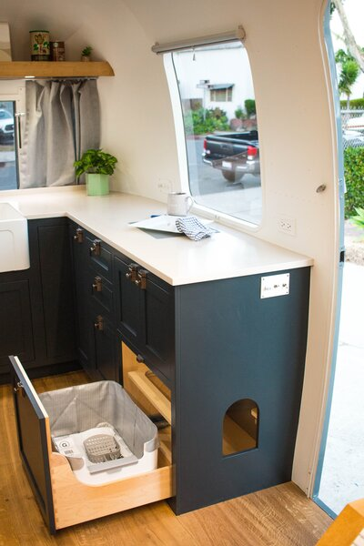 A litter box is tucked away in a pull-out drawer, so the family can bring their furry friend along on adventures.