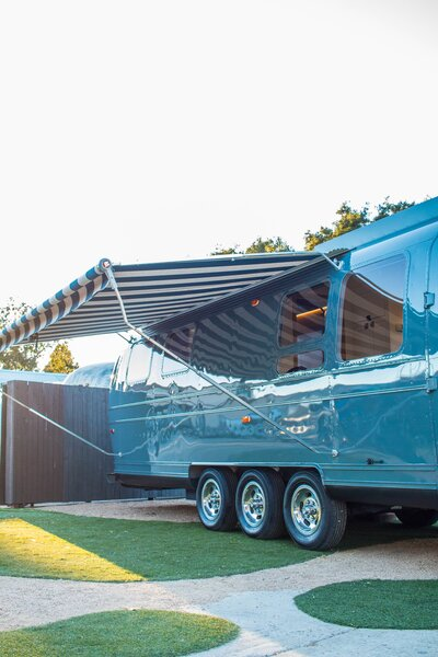 Outside, a large 15-foot awning allows the family to enjoy outdoor living.