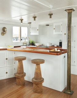 """""""Design choices, such as heavy bar stools in the kitchen, were made to ensure the boat could function well docked or at sea,"""" Lyndsay says."""