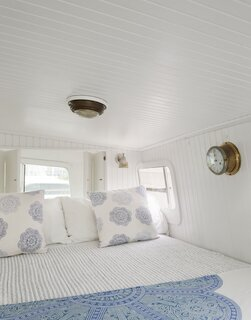 """""""Sleeping spaces are strategically configured to accommodate the family and guests,"""" Lyndsay says. She made sure to design the berths with ample storage."""