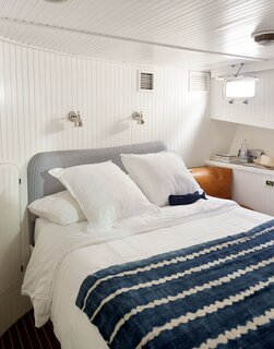 """Workstead sconces and lighting can be seen throughout the vessel. """"We added the reading lights and sconces to create a cozy atmosphere in the space,"""" Lyndsay says."""