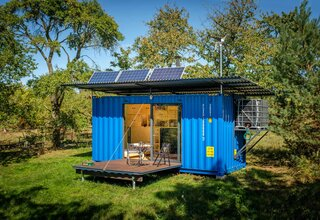 This eco-friendly escape is powered by solar panels and a wind turbine—and it even includes a full bath.