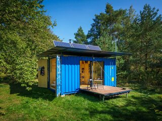 The eco-friendly escape is powered by solar panels and a wind turbine—and it even includes a full bath.