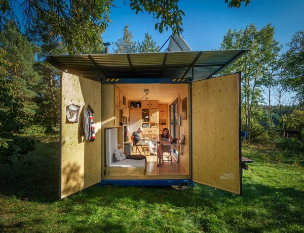 The design team sprayed the metal structure's inner walls with thermal insulation. Then they framed the interior with studs and clad it in spruce plywood.