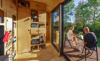 A sliding glass door opens onto a terrace.