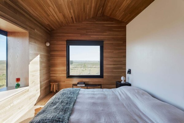 In the bedrooms, large windows provide views of the rolling prairie landscape.