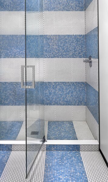 The wife selected blue and white penny tile, alternating the 1-foot sheets to create a dynamic striped design.