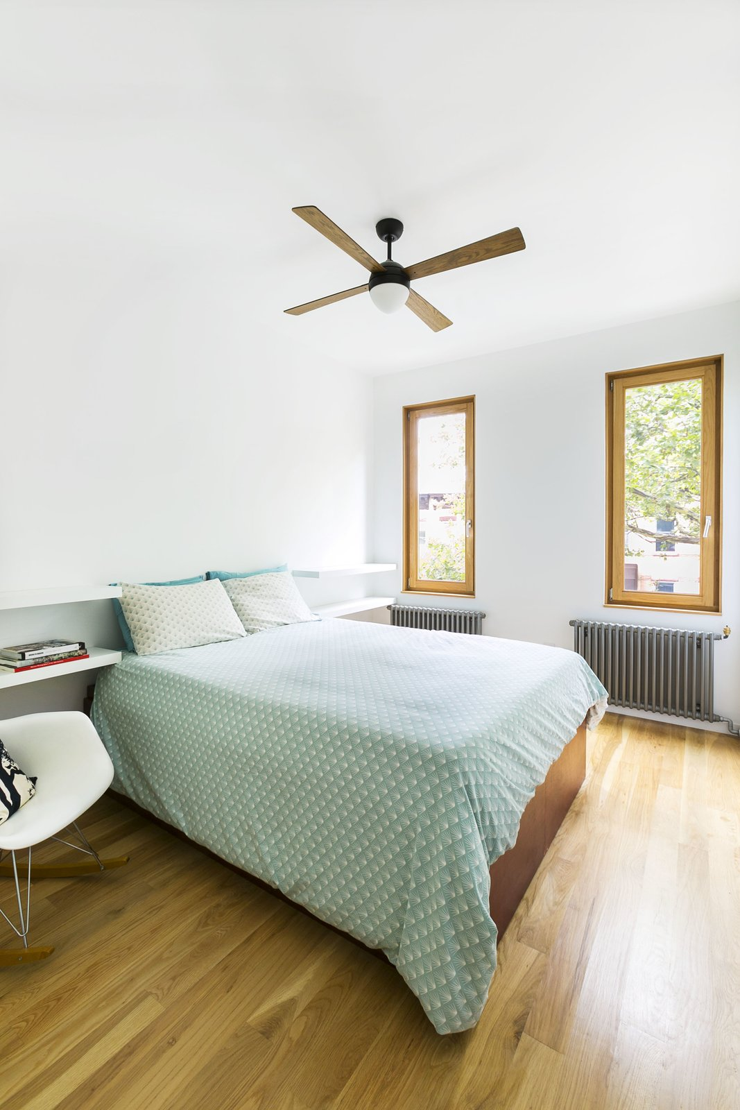 Bedroom, Bookcase, Chair, Bed, Light Hardwood Floor, and Ceiling Lighting The master bedroom.  Sunset Park Row House