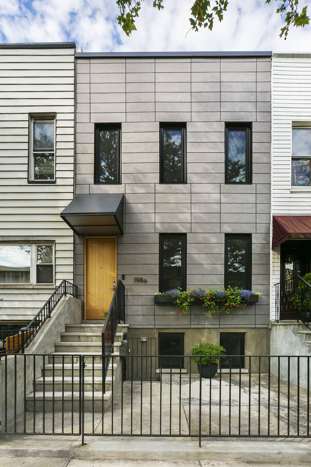 Outdoor, Front Yard, and Vertical Fences, Wall The front facade clad in fiber-cement board.  Sunset Park Row House