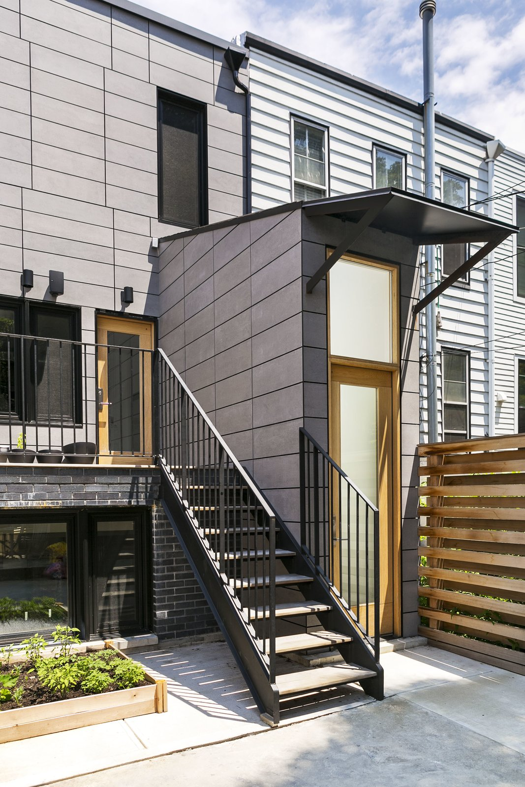 Outdoor, Small Patio, Porch, Deck, Wood Patio, Porch, Deck, Vertical Fences, Wall, and Back Yard Rear facade detail.  Sunset Park Row House