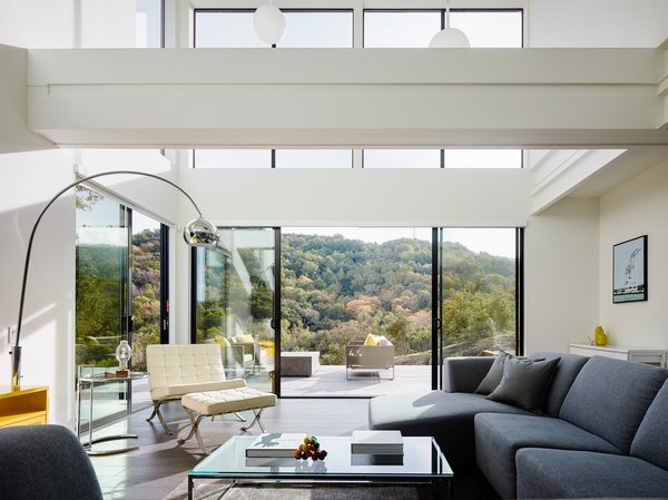 Natural light pours through the copious windows, filling the living areas with a sense of buoyancy, and allowing an unobstructed view of the vista beyond.