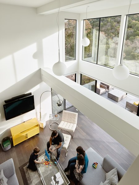 19' ceilings in the living room maximizing natural light to permeate the open spaces.