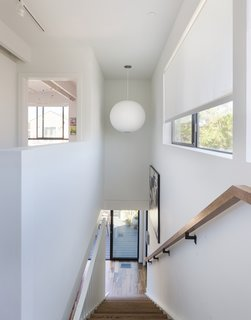 A George Nelson Bubble lamp hangs in the stairwell of Santa Monica Connect 4L.