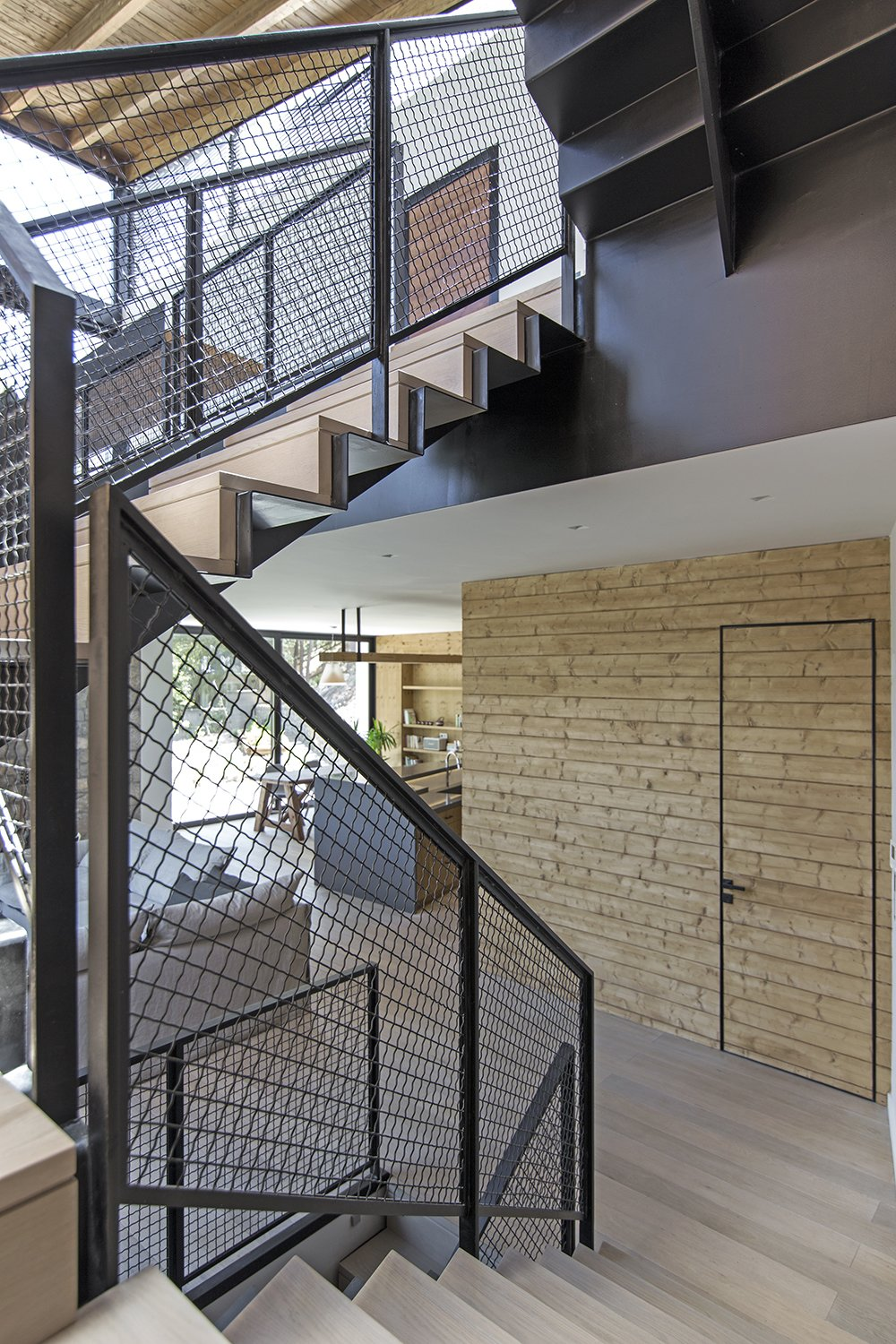 All finishes appear in their natural state Tagged: Staircase, Metal Tread, and Metal Railing.  The Wedge House