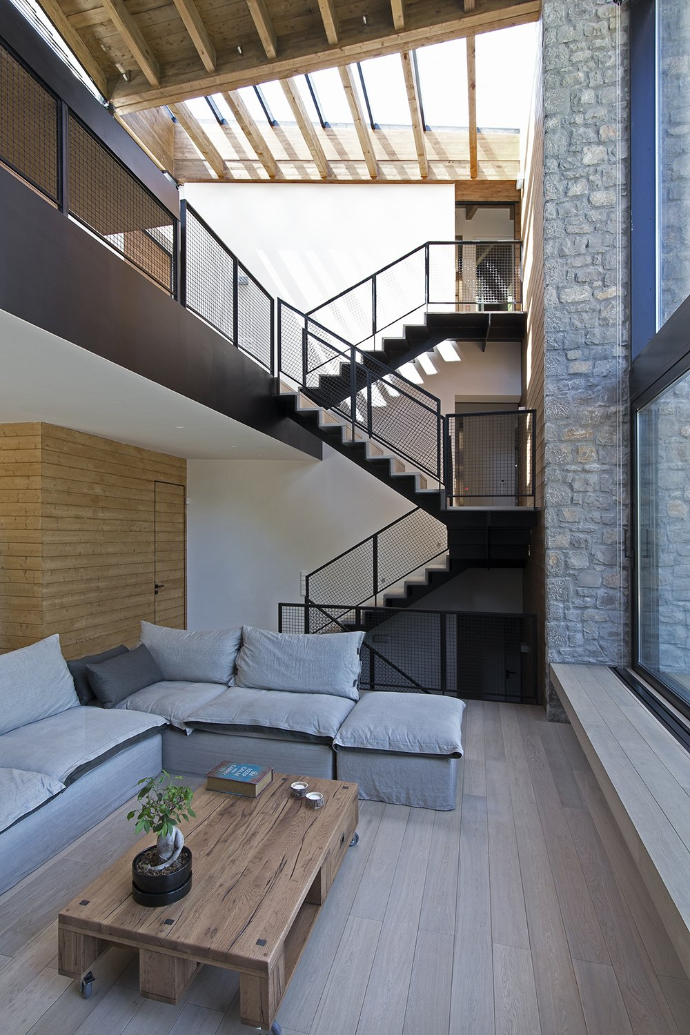 Staircase, Metal Tread, and Metal Railing The wedge permeates the roof as well, creating a skylight right above the metal stairway that leads down to the living room, kitchen and dining room  The Wedge House