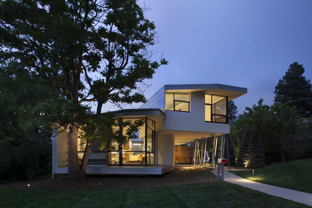 Exterior, House Building Type, Stucco Siding Material, Metal Siding Material, Metal Roof Material, Curved RoofLine, and Glass Siding Material Arch11-designed home at the base of Chautauqua Park in Boulder, CO  6th Street by Arch11