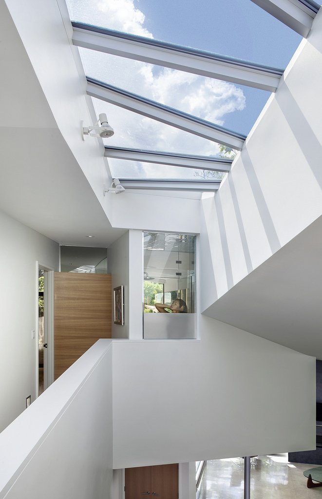 Hallway skylights flood the home with natural light and accentuate its unique geometry  6th Street by Arch11