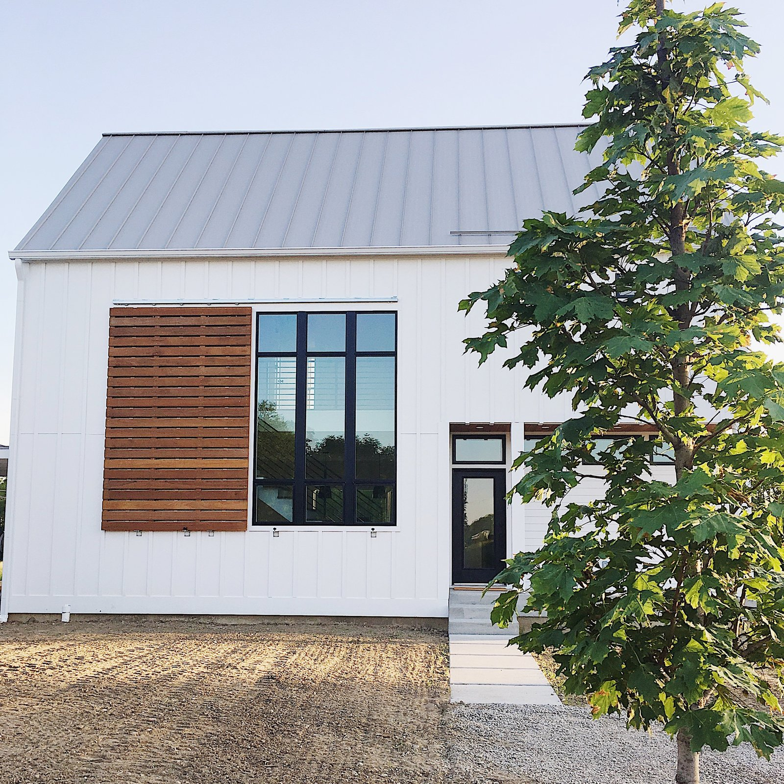 """Exterior, House Building Type, and Metal Roof Material We took inspiration from modern, scandinavian, and farmhouse design to achieve our very own style. The simple """"box"""" shape helped keep costs in check while the large windows, metal roof, and large ipe shutter created the perfect amount of interest.  The Simply Simple Home by Kelsey Johnston"""