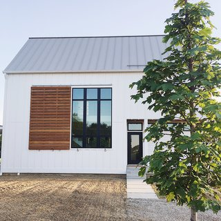"""We took inspiration from modern, scandinavian, and farmhouse design to achieve our very own style. The simple """"box"""" shape helped keep costs in check while the large windows, metal roof, and large ipe shutter created the perfect amount of interest."""