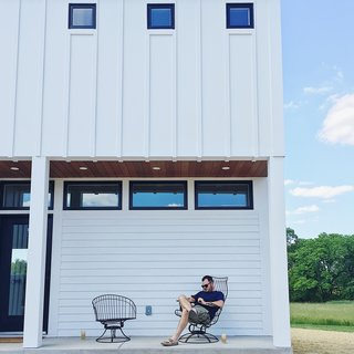 The front porch features ipe shiplap siding which ties in nicely with the ipe shutter.