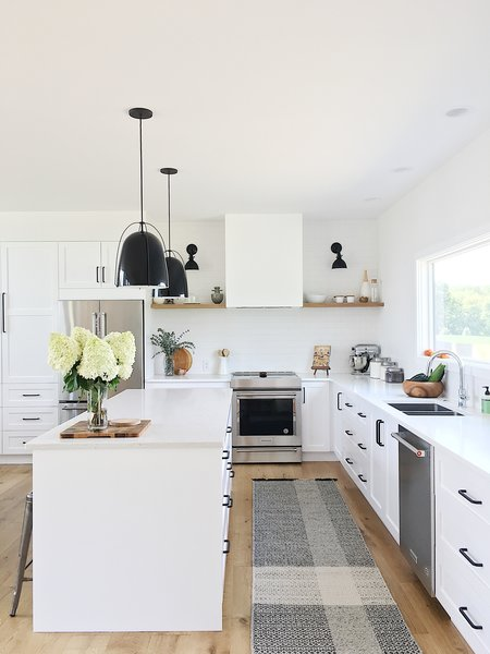 This kitchen features IKEA cabinet bases with Semihandmade fronts painted Dunn Edwards White. The lights & Best 60+ Modern Kitchen Wall Lighting Design Photos And Ideas - Dwell