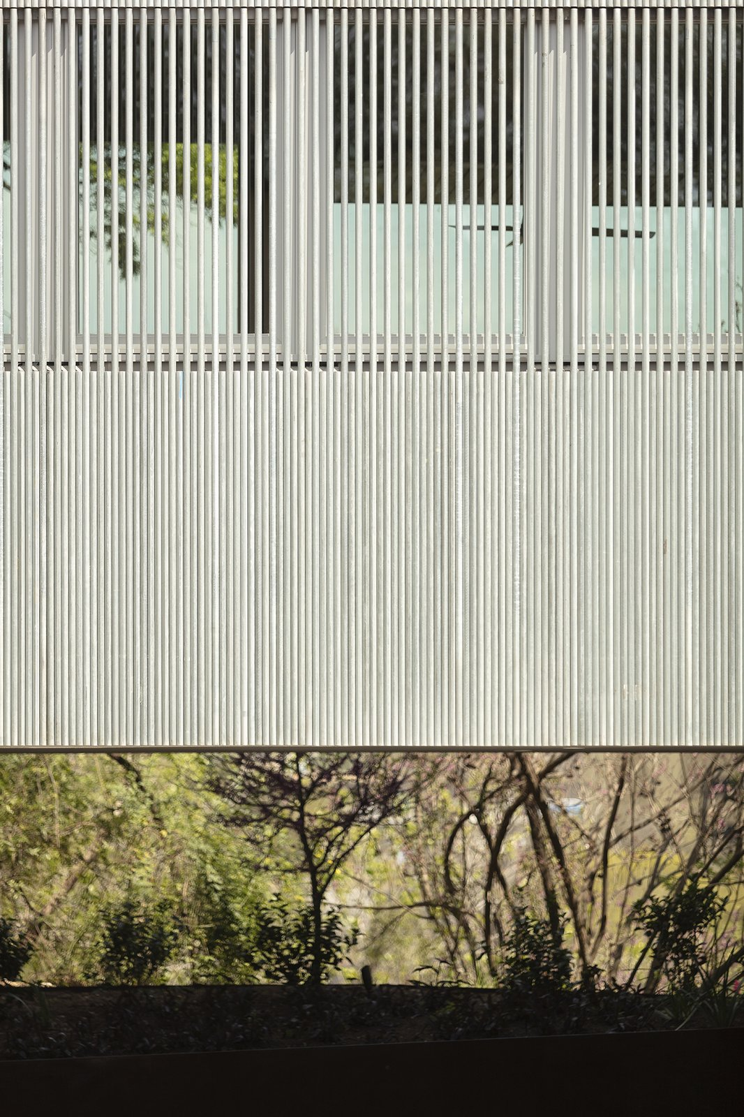 Exterior, Metal Siding Material, and House Building Type From the street, the Edgecliff Residence is characterized by a rainscreen made of galvanized electrical conduit—an inventive, low-cost solution that addresses several practical needs.  Edgecliff Residence by Miró Rivera Architects