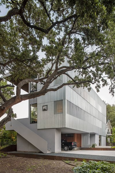 The Edgecliff Residence by Miró Rivera Architects is divided into three levels, with the guest quarters at ground level, living spaces on the second floor, and the master suite at the highest level.