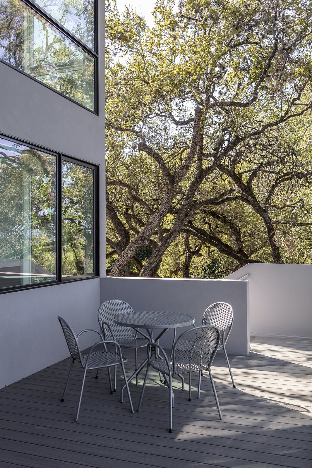 Exterior, House Building Type, Stucco Siding Material, and Glass Siding Material A sliding door opens onto a large outdoor deck that is connected to the yard via a staircase with a plate steel stringer.  Edgecliff Residence by Miró Rivera Architects