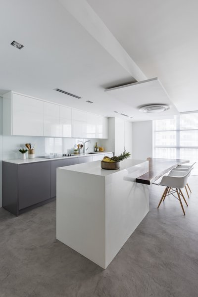 Beautiful modern kitchen , with concrete floor , amazing wooden table designed by Nathalie milazzo