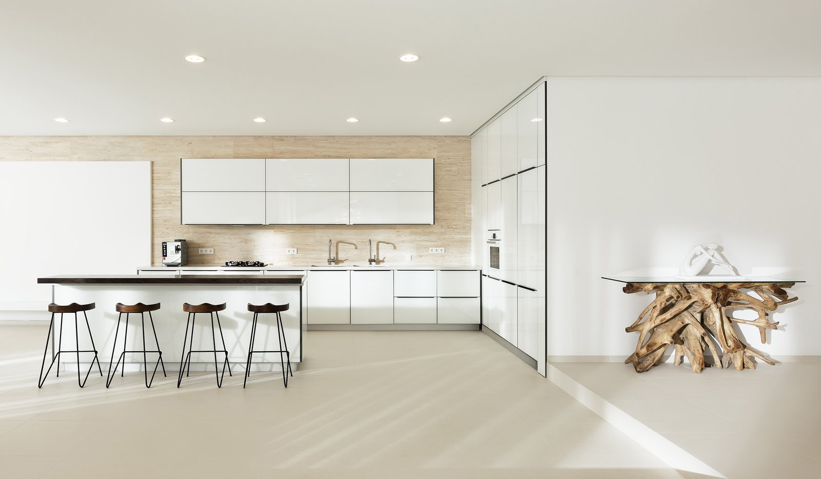 Kitchen, Quartzite, Stone, White, Wood, Metal, Travertine, Porcelain Tile, Stone Slab, Ceiling, Refrigerator, Wall Oven, Microwave, Dishwasher, Ice Maker, Cooktops, and Drop In WH Residence | M3 Architects  Best Kitchen Microwave Wood Refrigerator Travertine Stone Photos from WH Residence