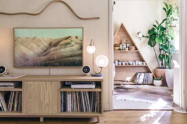 The credenza was handmade by San Francisco furniture maker Four / Quarter, while Katie Gong's wood squiggle rests above a Samsung Frame TV to add balance to the space.