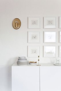 """My new favorite piece—well, pieces really—is my beautiful grid wall in my dining room,"