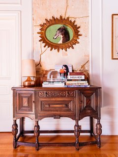 Chien's late dog, Thin Lizzie, is memorialized in her hallway over her grandmother's antique chest.