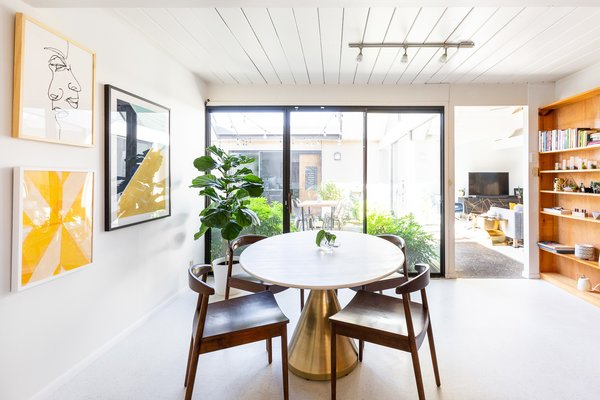 """""""A space in my house that I love is our bougie breakfast nook with the fancy marble table and brass pedestal bottom,"""" says Encarnacion."""