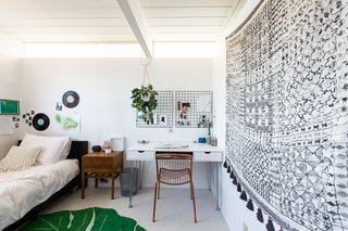 Airis, 14, has her own room room that's just as stylish as the rest of the house with modern boho vibes.