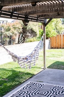 On warm days, Encarnacion can be found lounging in her hammock in the backyard.
