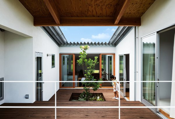 The center of the home is an open-air atrium with access from multiple rooms.