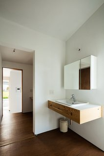 A floating sink and mirror add to the airy feel of the home, creating a larger sense of space.