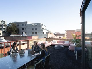 The 1,500-square-foot terrace serves as a casual lounge space, cafe-style seating, marble tables, and ergonomic, heated seating by Galanter & Jones. The awning, made of recycled sails in collaboration with Mafia Bags founder Marcos Mafia, protects from the elements.