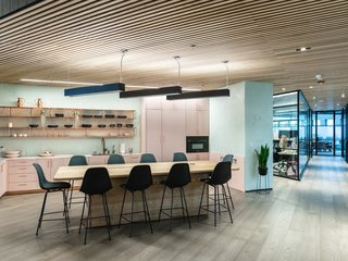 Pink quartzite finishes and blackened plywood bulkheads make up the kitchen area, along with ceramics from Year & Day.