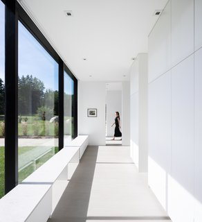 The entire home is encased in glass and soaked in natural light.