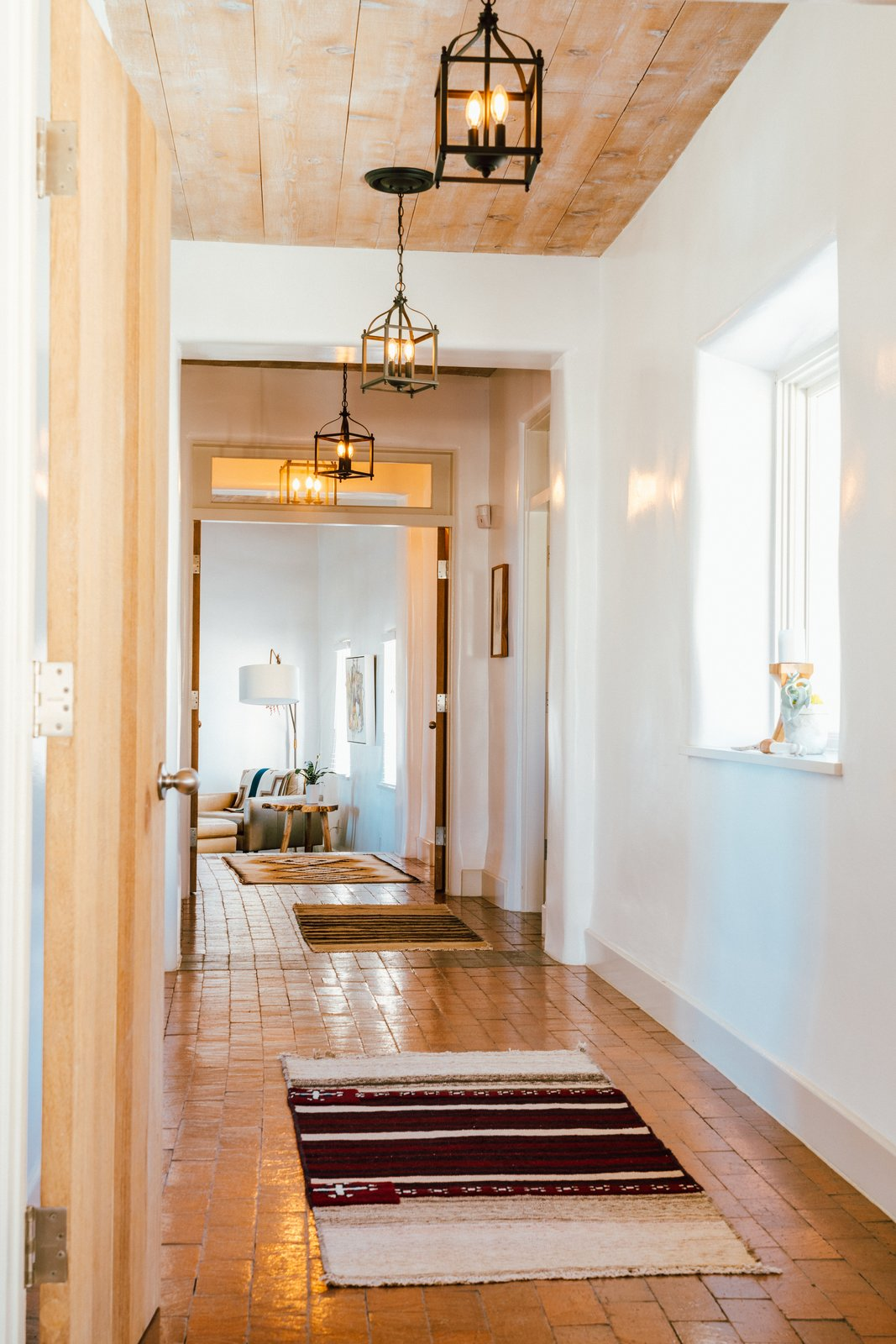 Melissa Young desert hacienda hallway with rugs