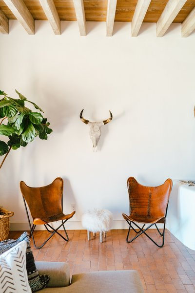 The 18-inch-thick adobe walls keep the house cool in the summer and cozy in the winter. An animal-themed nook situated next to a fiddle-leaf fig calls to mind a safari adventure.