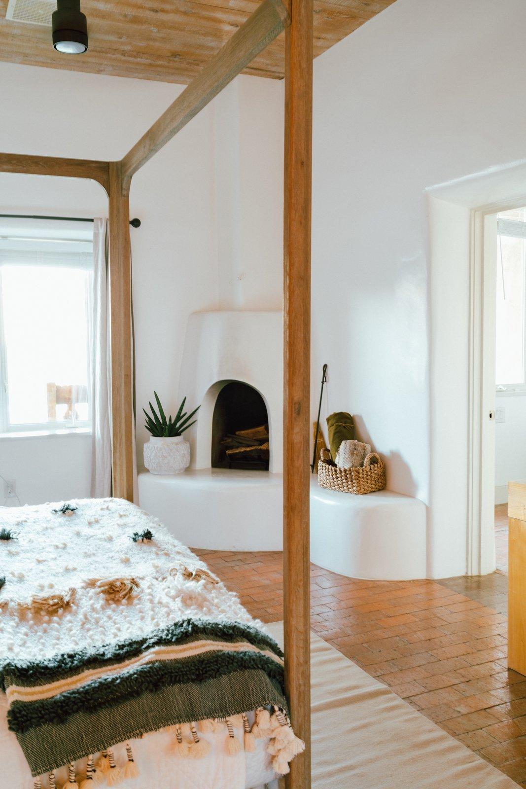 Melissa Young desert hacienda master bedroom with kiva fireplace