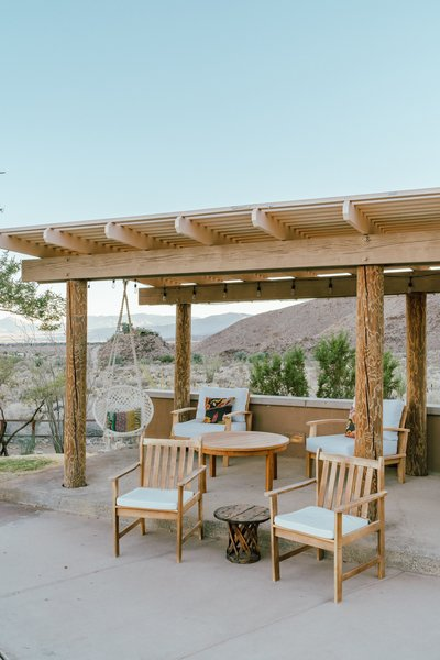 """The loggia poles around the hose at all patio areas were painted a dark green. We had them sanded to bring back their original rustic wood glory."""