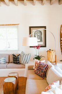 An eclectic display of pillows showcases Young's affinity for textiles.
