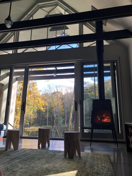 A glass wall opens up the indoor living area to the great outdoors.