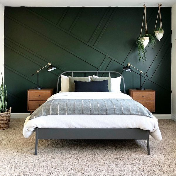 To create this accent wall, Rose measured and cut each piece of wood at 30 and 60 degree angles, nailed them into the wall, caulked, and spray painted. This cost her a total of $20. The bed frame, she snagged from Ikea (Kopardal). Bedding is Nate Berkus from Target, and the throw is Opalhouse from Target.